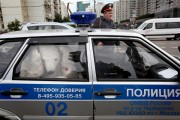 A Greenpeace activist dressed up as a polar bear is arrested and taken away to the police station.