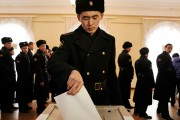 A Russian Navy officer votes in an election that has been statistically proven to be rigged by Austrian statisticians