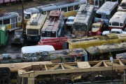 Buses, trams, and cars in a scrapyard in Moscow