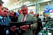 Dmitry Rogozin looks at a gun