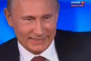Vladimir Putin laughs at the press conference