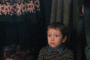 A boy in shock after Putin speaks to him