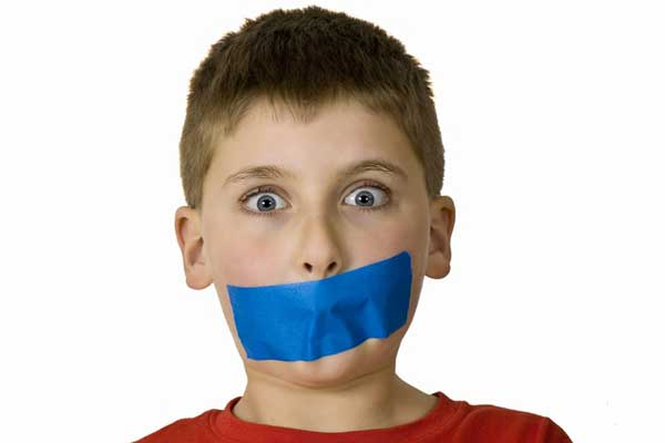 Boy with mouth taped shut
