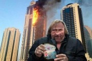 Photoshop of Depardieu standing in front of the burning building, from http://gazetaby.com/cont/art.php?sn_nid=55424