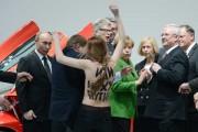 Putin looks a naked member of Femen in the... eye?
