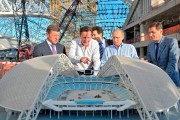 David Cameron and Vladimir Putin look at a mock-up of one of the arenas.
