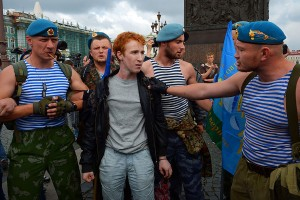 A gay man surrounded by paratroopers