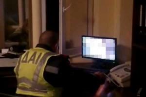 Traffic policeman watching porn